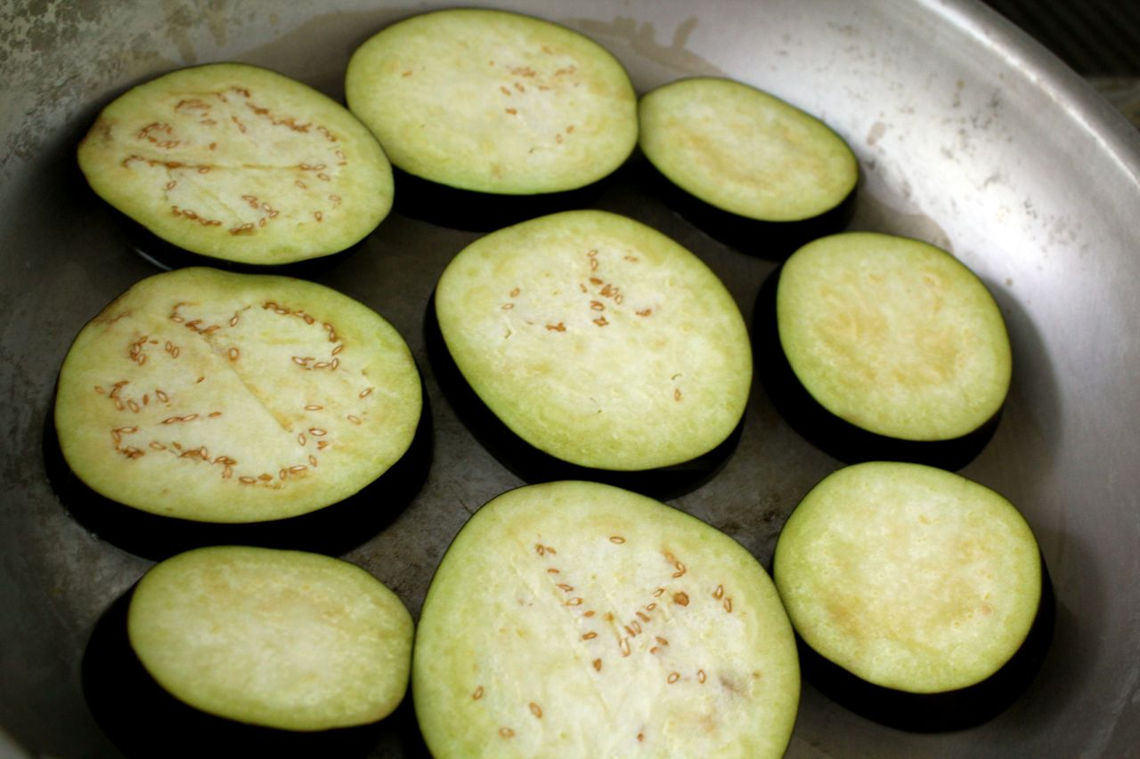 While your eggplant is frying, you can make the Israeli salad. Dice up ...