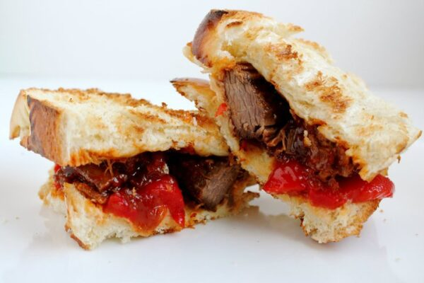 Brisket Sandwich with Horseradish, Onion & Pepper on Challah